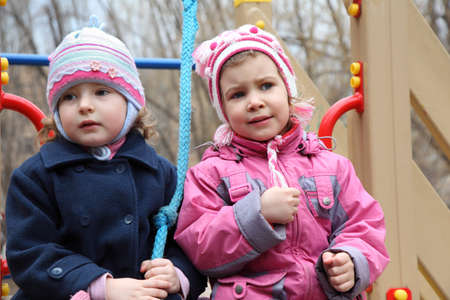 deplorable: Two thoughtful girls on playground Stock Photo