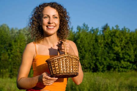 Young Women with basket on glade Stock Photo - 7838086