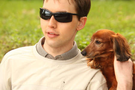 blind young man with dog-guide photo