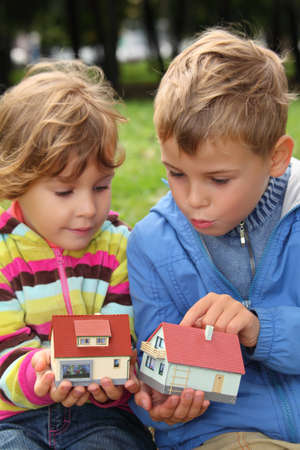 children  with toy small houses in hands outdoor Stock Photo - 7838141
