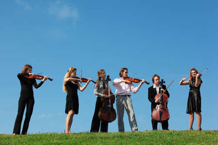 Six musicians play violins against sky Stock Photo - 7837844