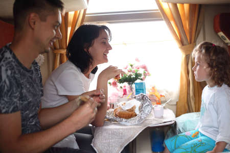family eats in train photo