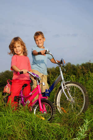 young smiling bikers rest outdoors photo