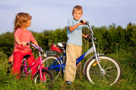 young bikers rest in the field photo
