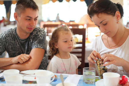 family in cafe, hotel restaurant photo