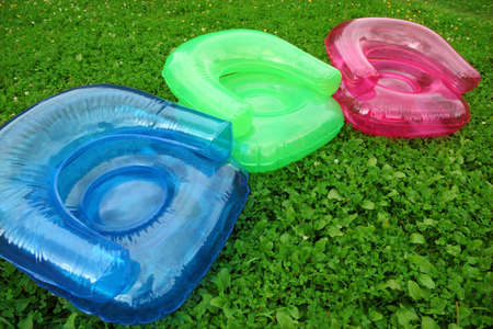 three Inflatable armchairs on lawn Stock Photo - 7791575
