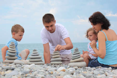 builds: family builds  stone stacks on pebble beach