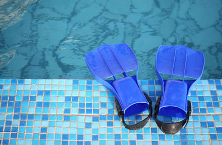 brink: flippers on the brink of pool Stock Photo