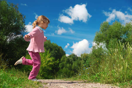 across: little girl runs across path outdoor