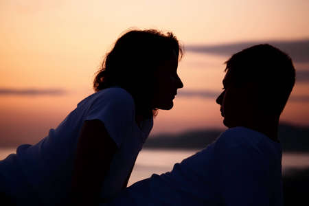 silhouette man and woman on beach photo