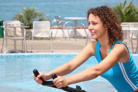 girl on training apparatus outdoor on beach photo