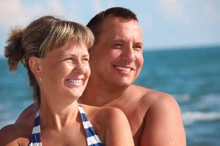 portrait of pair against sea photo