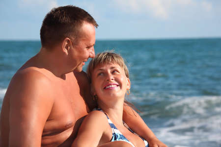 middleaged portrait of pair against sea photo