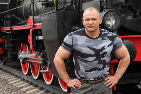 strong man against locomotive photo