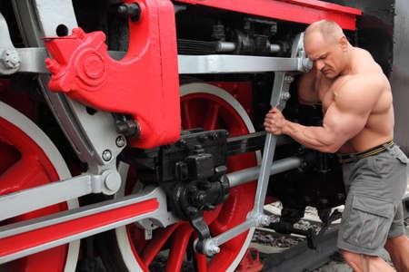athlete checks locomotive condition photo