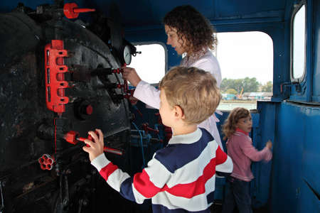 Mother with children in locomotive cabin Stock Photo - 7831801