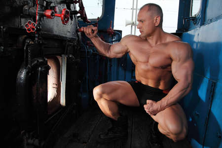 athlete looks in  locomotive fire chamber photo