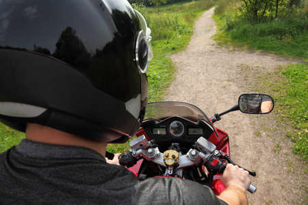 road shoulder: motorcyclist on country road, shoulder view