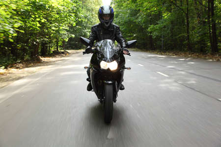 motorcyclist goes on road, front view Stock Photo - 7792106