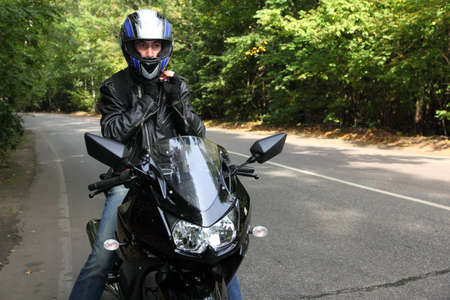 motorcyclist standing on road Stock Photo - 7831907