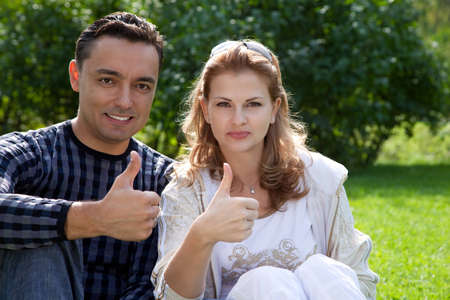 married couple with their thumbs up  photo