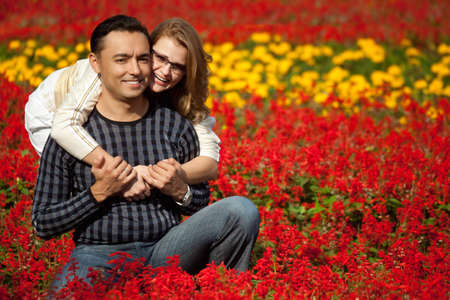 man and woman in brackets laughing in the flowers Stock Photo - 7831874