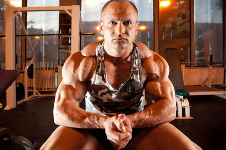 bodybuilder sits in training room Stock Photo - 7831804