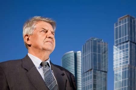 senior man near skyscrapers construction Stock Photo - 7831571