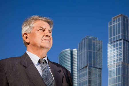 senior man near skyscrapers construction Stock Photo - 7831571