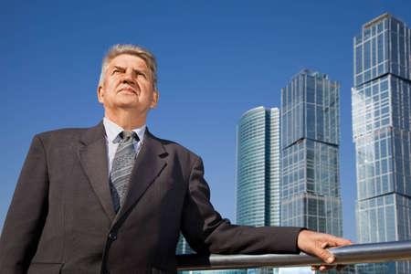 senior man near skyscrapers construction Stock Photo - 7838912