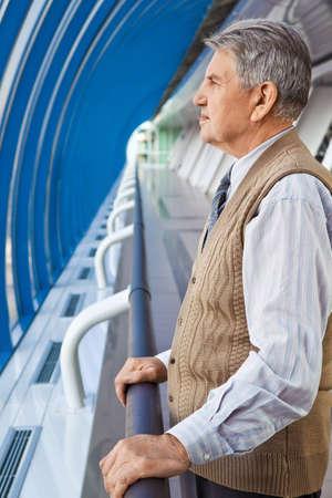Senior man near window on bridge Stock Photo - 7839068