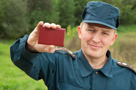 carta identit�: officer of rescue service showing his identity card