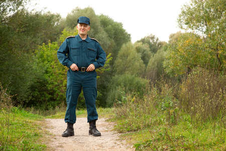 rescue service: officer of rescue service standing on footpath outdoors