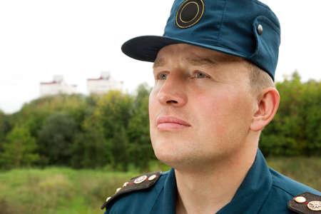 rescue service: officer of rescue service looking in the sky