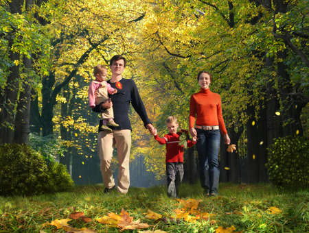 walking family with two children in autumnal park collage photo