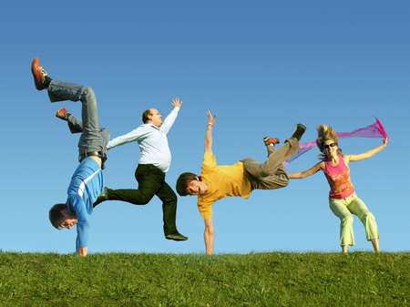 freedom fun: Many jumping people on the grass, collage