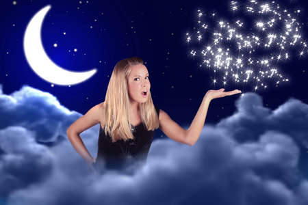 a girl holds something on a hand in sky with a moon and stars photo