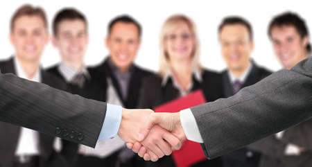 shaking out: shaking hands with wrists and six business group out of focus collage Stock Photo