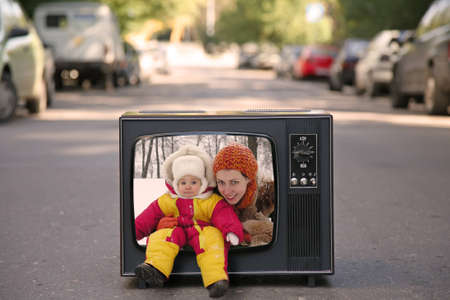 mother and baby are in the old television set collage photo