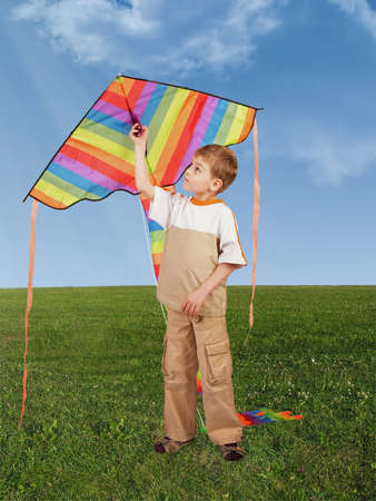 child on grass with kite, collage      photo