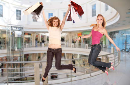 retail place: jumping girls in shopping center, collage