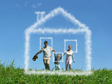 family with boy on meadow and dream cloud house collage photo