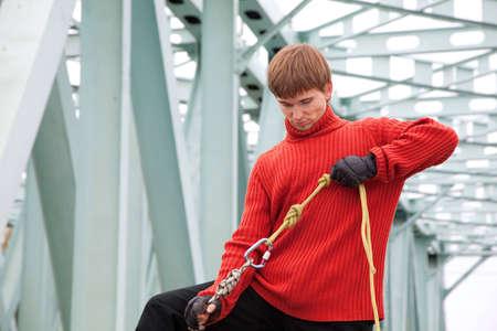 man with equipment rope bridge photo