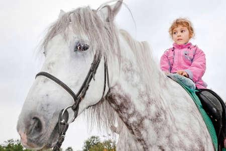 horse sleigh: girl riding horse