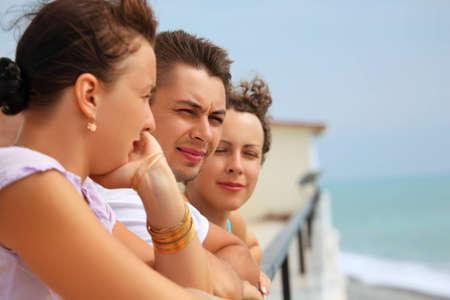 three friends on balcony photo