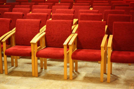 red wood chairs in auditorium photo