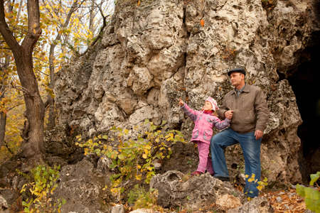 grand daughter: The grandfather and grand daughter are near the cavern