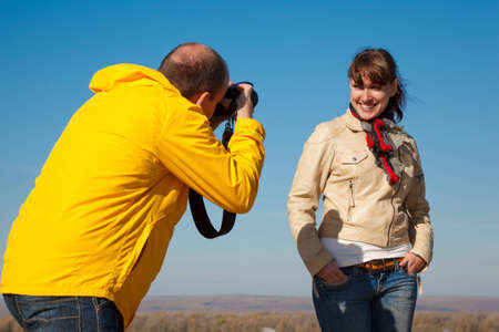 unites: Girl poses for photographer, photosession on nature. Hobby which unites people.