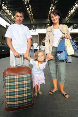 Happy family with little girl at railway station, focus on daughter Stock Photo - 9113282
