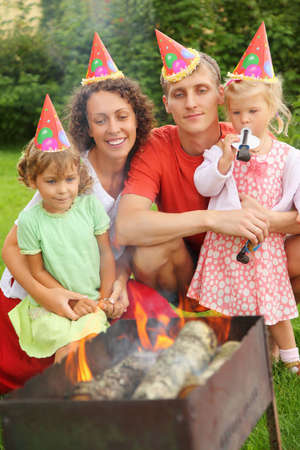 Happy family with children near brazier on picnic, happy birthday party seven years Stock Photo - 9112112